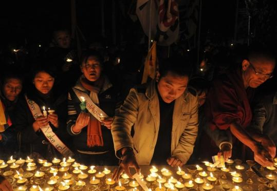 Exiled Tibetans held a candlelit vigil yesterday in Dharmsala, India. Hundreds of schoolchildren gathered at the Tsuglakhang templ