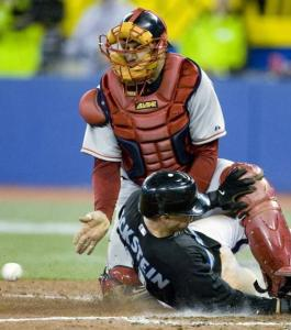David Eckstein slides in safely under Sox catcher Jason Varitek in the sixth inning.