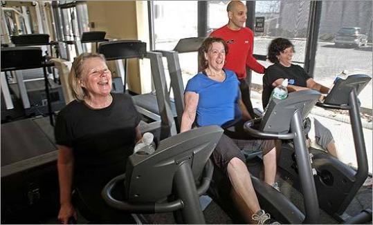 Bryan Agurcia coaches (from left) Sheila Davis, Judi Robbins and Susan Rains last month