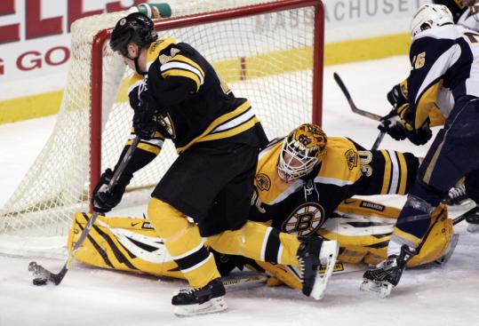 Bruins defenseman Aaron Ward skates the puck away from the Bruins' net in the first period.