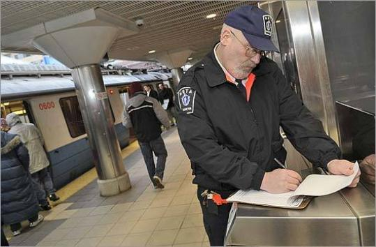 MBTA inspector Bill Donovan, of Amesbury, checks records at the Wonderland station on the Blue Line, the northern end of the line.