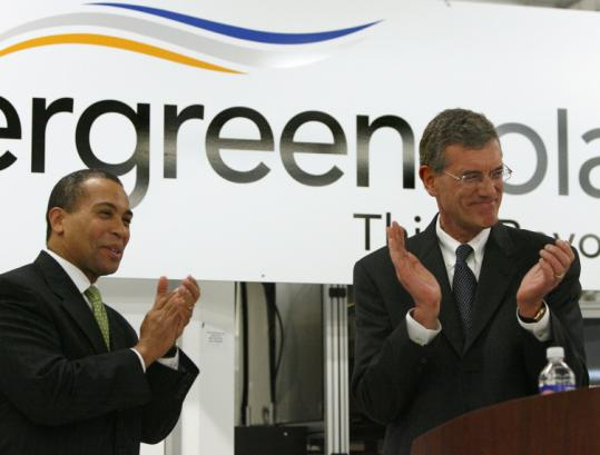 Evergreen Solar's CEO, Richard M. Feldt (right), says Governor Deval Patrick's commitment to solar power played a key role in the company's decision to expand in Massachusetts.