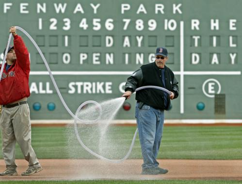 The grounds crew, including head groundskeeper David Mellor (right) and his number two assistant, Weston Appelfeller, got everything in order for Tuesday.