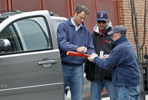 There was no official workout Monday, as the players were given a well-earned day off, but that didn't stop starting pitcher Jon Lester (left) from showing up at the park. He signed an autograph for a fan outside of his truck near Fenway Park.