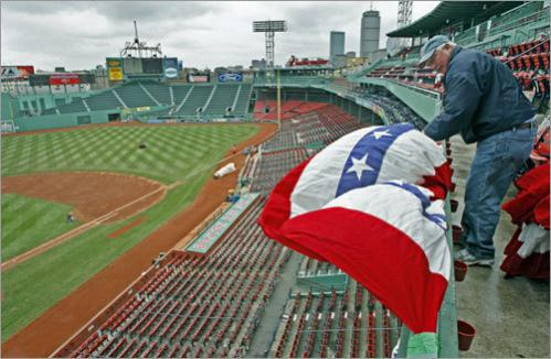 David Batchelder of Alden Flag in Rhode Island is shown as he hangs the ceremonial bunting on the facade high above the first base line.
