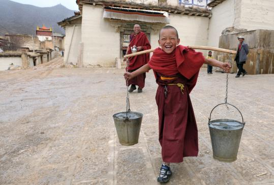 A young monk in Tibet, where tourism has suffered after a crackdown by Chinese security forces.