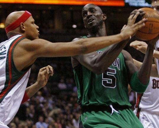 The Bucks' Charlie Villanueva reaches out and touches Boston's Kevin Garnett - earning a foul in the first half.