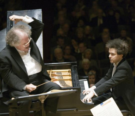 Soloist Evgeny Kissin (right) joined James Levine and the Boston Symphony Orchestra Tuesday night for Brahms's Piano Concerto No. 2.