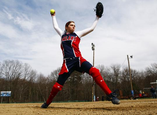 Ashland High ace Nicole D'Argento, gearing up for Dover-Sherborn last week, has years of experience pitching from 43 feet.