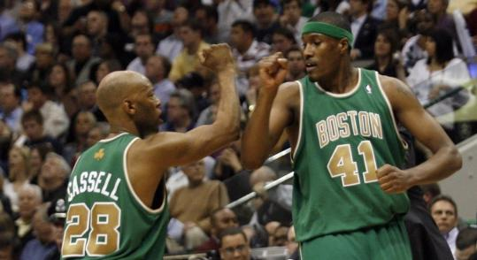 Sam Cassell (left, with James Posey) owns two NBA championship rings and knows the first playoffs games in Boston will 'get crazy. It's going to be bananas . . .'