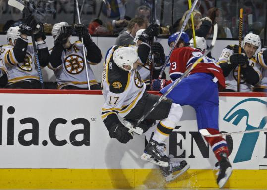 Bruin Milan Lucic brought his rough-and-tumble style to his playoff debut, meeting up with Michael Ryder in the third.