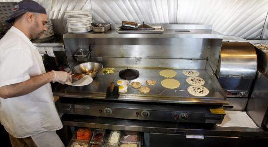 The Deluxe Town Diner is favored by locals for its sweet potato pancakes and challah French toast.