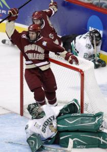 Boston College forward Andrew Orpik celebrates his goal over the University of North Dakota with an assist from linemate Kyle Kucharski (rear) in Thursday's Frozen Four semifinal.