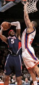 Hawks' Josh Smith (24 points) shoots over the Knicks' Wilson Chandler in Atlanta's victory.