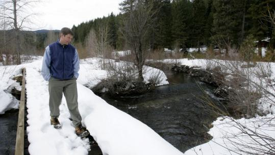 Curtis Knight, of California Trout Inc., walked on a bridge crossing Squaw Valley Creek near McCloud, Calif., last month. A bottling plant deal could affect the creek's water flow.
