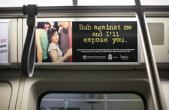 This ad warning against sexual harassment is one of at least three posted on Red Line trains. The MBTA will officially unveil the camp