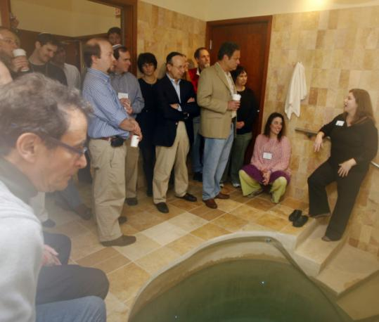 Dr. Bob Levenson addressed a group of mohels-in-training after they toured a temple in Newton.