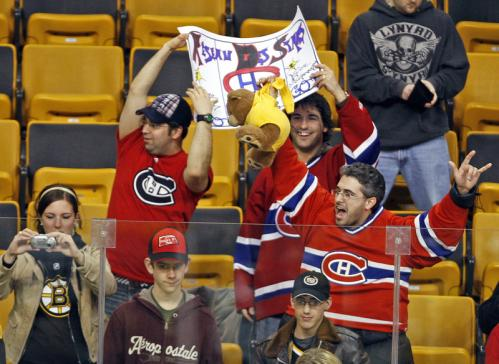 Before the start of the Bruins-Canadiens at the Garden, Montreal fans were out in force in the stands, including one with a 'Bruins' bear by the scruff of its neck.
