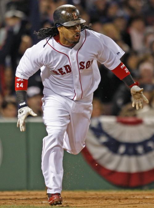 Manny Ramirez heads to first base after delivering an RBI single in the first inning.