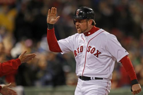 Sean Casey celebrates after scoring during the third inning.