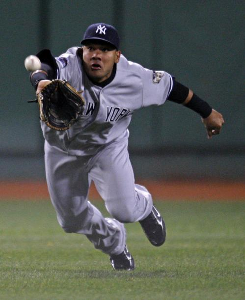 Melky Cabrera makes a diving catch on a ball hit by Jacoby Ellsbury in the eighth inning. It turned out to be a sacrifice fly for Ellsbury.