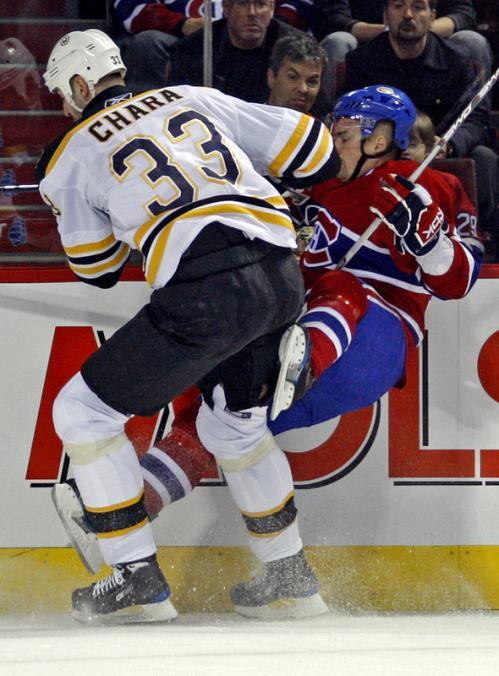 Boston's Zdeno Chara (33) checks Montreal's Thomas Plekanec.