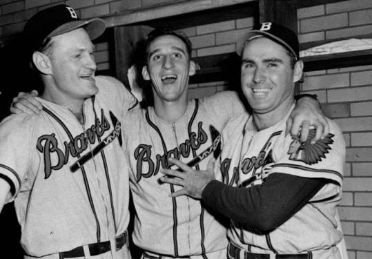 Tommy Holmes (right), celebrating a World Series win with Warren Spahn (center) and Bob Elliott. Mr. Holmes played a decade with the Boston Braves.