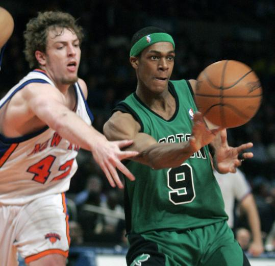 With 23 points, Rajon Rondo (right) was too much for David Lee and the Knicks to contain.