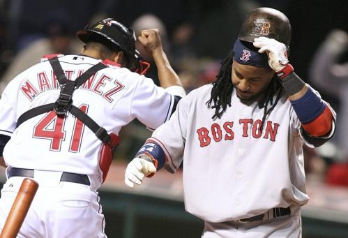 Manny Ramirez, right, removes his helmet after striking out in the seventh inning while Indians catcher Victor Martinez pumps his fist as he leaves the field.