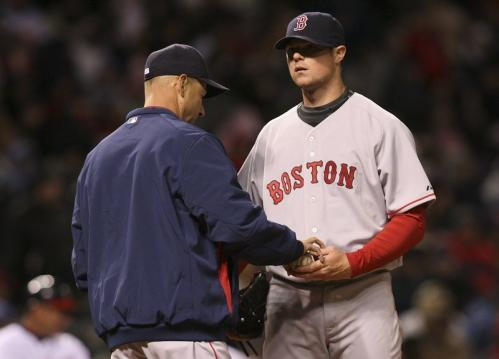 Red Sox starting pitcher Jon Lester gives the ball to manager Terry Francona as he is removed from the game in the fifth inning.