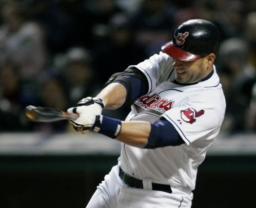 Cleveland Indians designated hitter Travis Hafner singles to drive in two runs in the fifth inning.