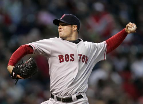 Red Sox starting pitcher Jon Lester delivers a pitch in the second inning.