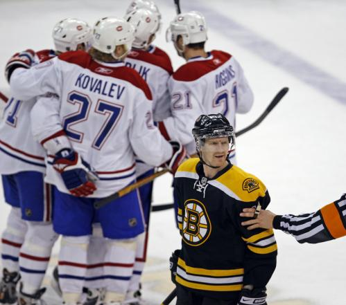 The Canadiens celebrate the first goal of the game, but the Bruins PJ Axelsson is upset and he lets a ref know it.