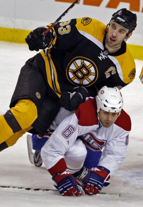 Boston's Zdeno Chara leans on Montreal's Tom Kostopoulos.
