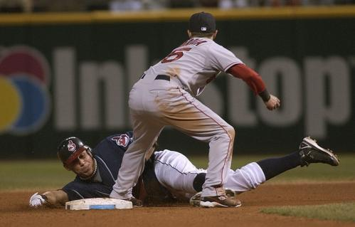 Cleveland's Asdrubal Cabrera (bottom) is tagged out by Dustin Pedroia while attempting to steal second base in the sixth inning.