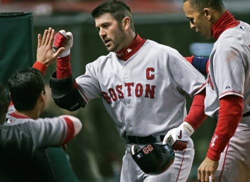 Boston captain Jason Varitek is congratulated at the dugout after his solo home run off Cleveland Indians relief pitcher Jensen Lewis in the ninth inning broke a late tie.