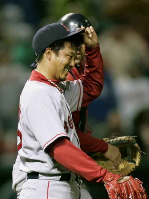 Red Sox relief pitcher Hideki Okajima smiles after getting the save in Boston's 5-3 win over the Cleveland Indians.