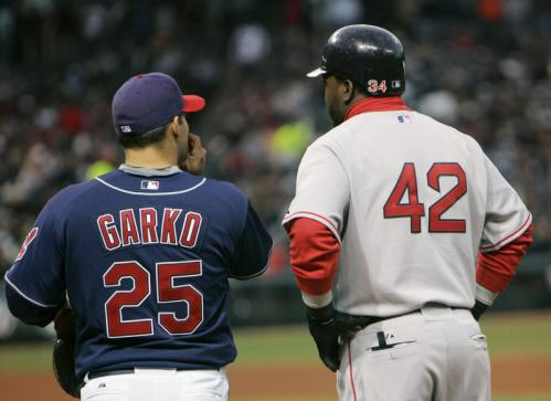 David Ortiz (42) talks to Cleveland Indians first baseman Ryan Garko after Ortiz's fourth-inning single. Ortiz wore No. 42 instead of his usual No. 34 to honor Jackie Robinson.