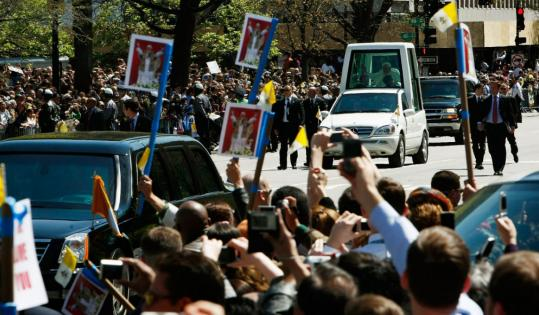 Pope Benedict XVI waved to cheering spectators on Pennsylvania Avenue after leaving the White House following a meeting with President Bush yesterday,