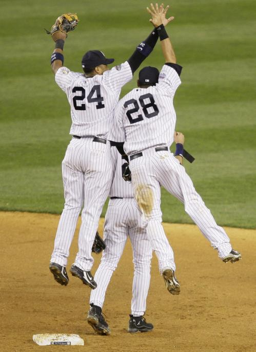 Robinson Cano, left, and Melky Cabrera leap to exchange high-fives after the Yankees beat the Boston Red Sox, 15-9.