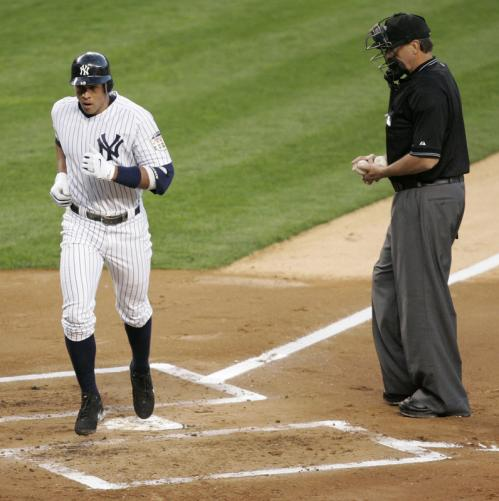 Alex Rodriguez crosses the plate after hitting a solo home run against the Boston Red Sox during the first inning.