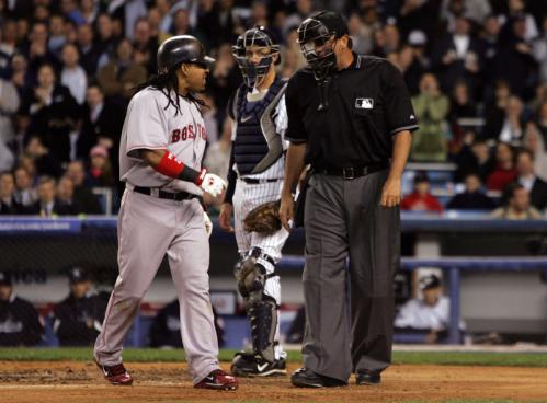 Manny Ramirez argues with home plate umpire Tim McClelland.