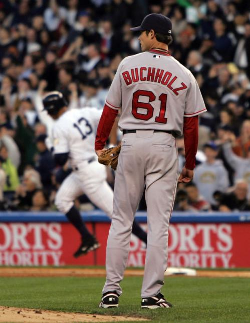 Clay Buchholz (61) looks into the outfield after surrendering a home run to Alex Rodriguez.
