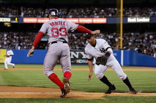 Alex Rodriguez (13) forces Jason Varitek (33) out of the baseline for an out in the second inning.