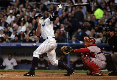 Alex Rodriguez (13) of the New York Yankees hits a home run in the first inning against the Boston Red Sox.