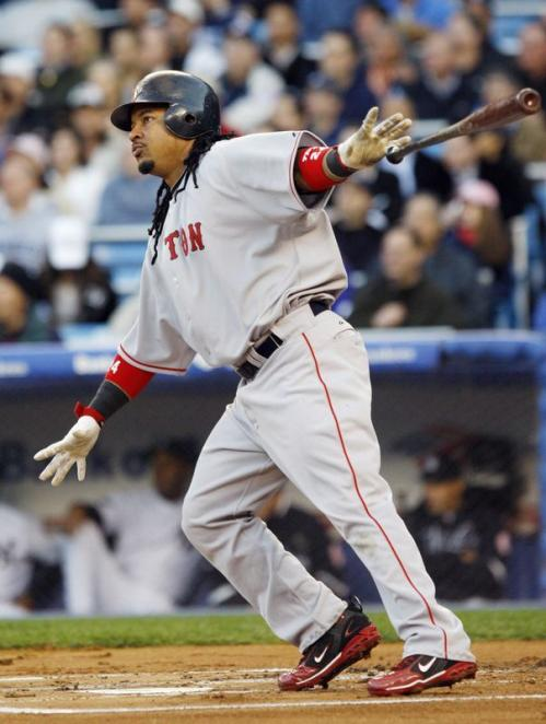 Manny Ramirez hits an RBI double in the first inning off New York Yankees starting pitcher Chien-Ming Wang.
