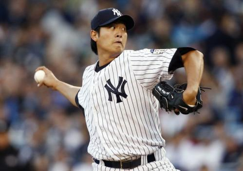 New York Yankees starting pitcher Chien-Ming Wang throws against the Boston Red Sox during the first inning.