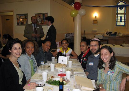 Among the guests at the Cape Verdean Seder last week at St. Patrick's Church in Roxbury were Joy Silverstein, Maria Santos, Shanice Lopes, Pamela Santos, Sophia Santos, Joseph Berman, and Rabbi Stephanie Kolin.
