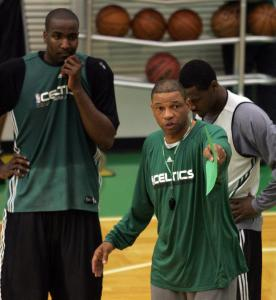 As coach, Doc Rivers (center) can only point out the problems that his Celtics might face tonight against the Hawks.
