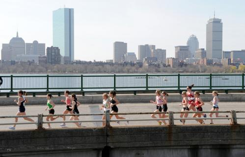 The runners took to Memorial Drive in Cambridge, with the Boston skyline in the background.